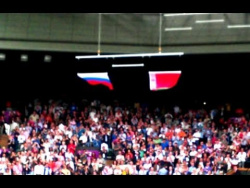 US flag falls at the first chords of the Russian national anthem.