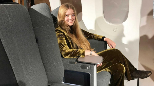 Folding airplane seat designed for sleeping in economy