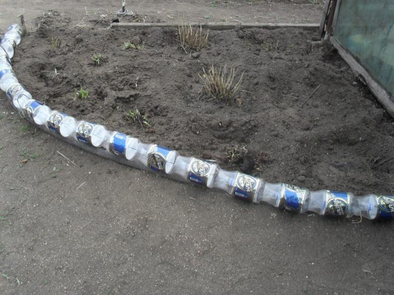 Клумбы из пластиковых бутылок: как сделать качественно 47