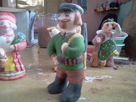 Кукла из красной глины