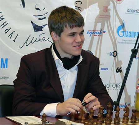Магнус Карлсен.  <div id=