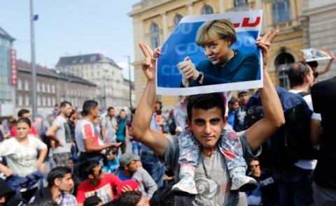 «Новая»Меркель: беженцы назв…