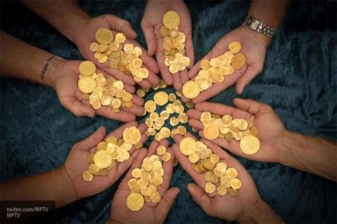 Золотые монеты в копилку РФ:…