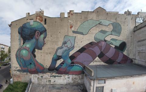 Испанский уличный художник Aryz и его впечатляющие картины на стенах домов