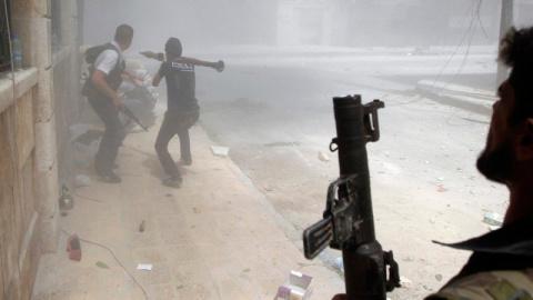 Сирия: жители города Кафр На…