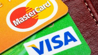 Российские банки не смогли заказать карты Visa и MasterCard из-за санкций