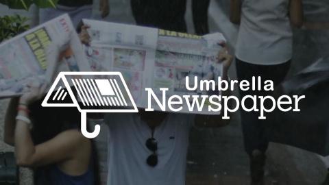 Газета-зонтик спасет от дождя