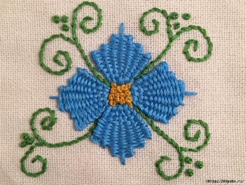 Красивая вышивка, сделанная переплетением нитей!