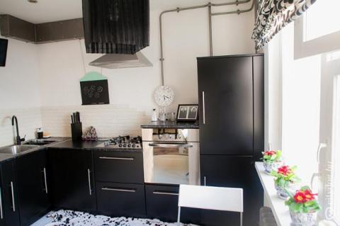 Минимализм на черной угловой кухне