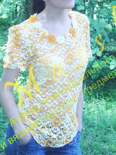 Вязанная женская безрукавка на спицах