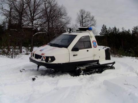 Снегоход с закрытой кабиной …