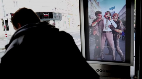 Billboard Prank Ad Delivers Zombie Scares To Unsuspecting People At A Bus Stop